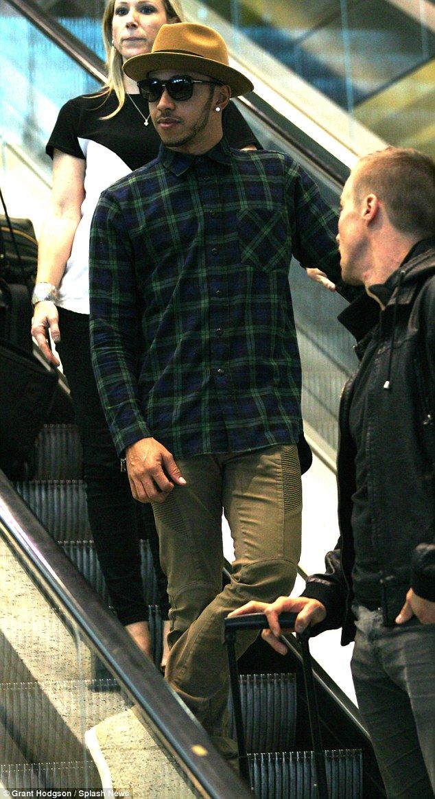 On a high: Lewis Hamilton was spotted on Monday at Melbourne airport following his big win at the Australian Grand Prix on Sunday