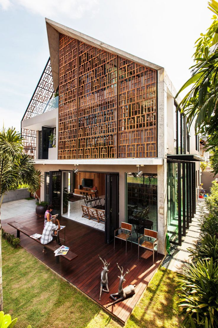 Teak Screens Provide Privacy, Natural Light And Ventilation In This Home