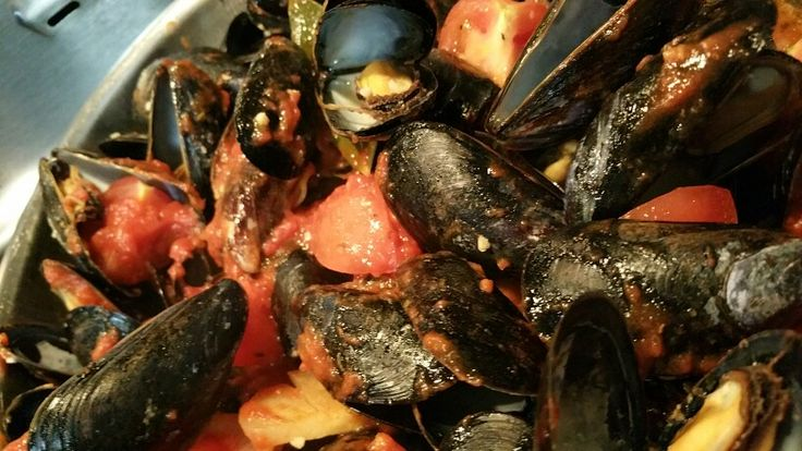 Tomato basil mussels  Fry EVOO, ONIONS, GARLIC  Add DICED TOMATO, BASIL, SALT, PEPPER  After 15 - 20 minutes - once mussels have opened - Serve with toasted bread