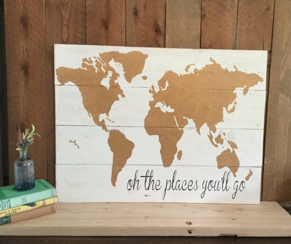 Oh the places youll go....  Get ready to conquer the world, or at least plot out your adventure, with this wooden map sign! This world map sign is expertly handcrafted from solid cedar planks painted with white coloring and hand painted with gold embellishments. This piece of rustic home décor is the perfect gift for the adventurer, swashbuckler, or traveler in your life.  The purchase of this listing is for one f wooden sign that measures approximately 32 x 22 inches.  These world map signs…
