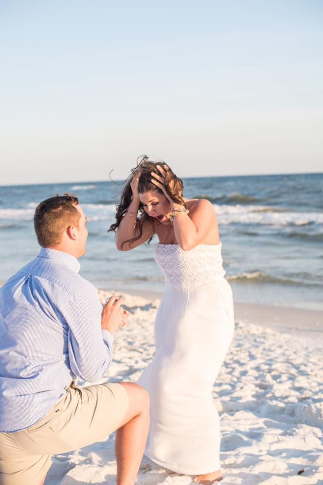 He proposed on the beach, and she was beyond surprised! Their whole story is so adorable.