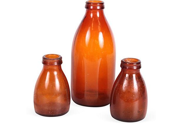 "Amber Milk Bottles  Danish  Small:  4.5""H x 3""D  Large: 8.5""H x 4""D  ($125.00)  $59.00   OneKingsLane.com"