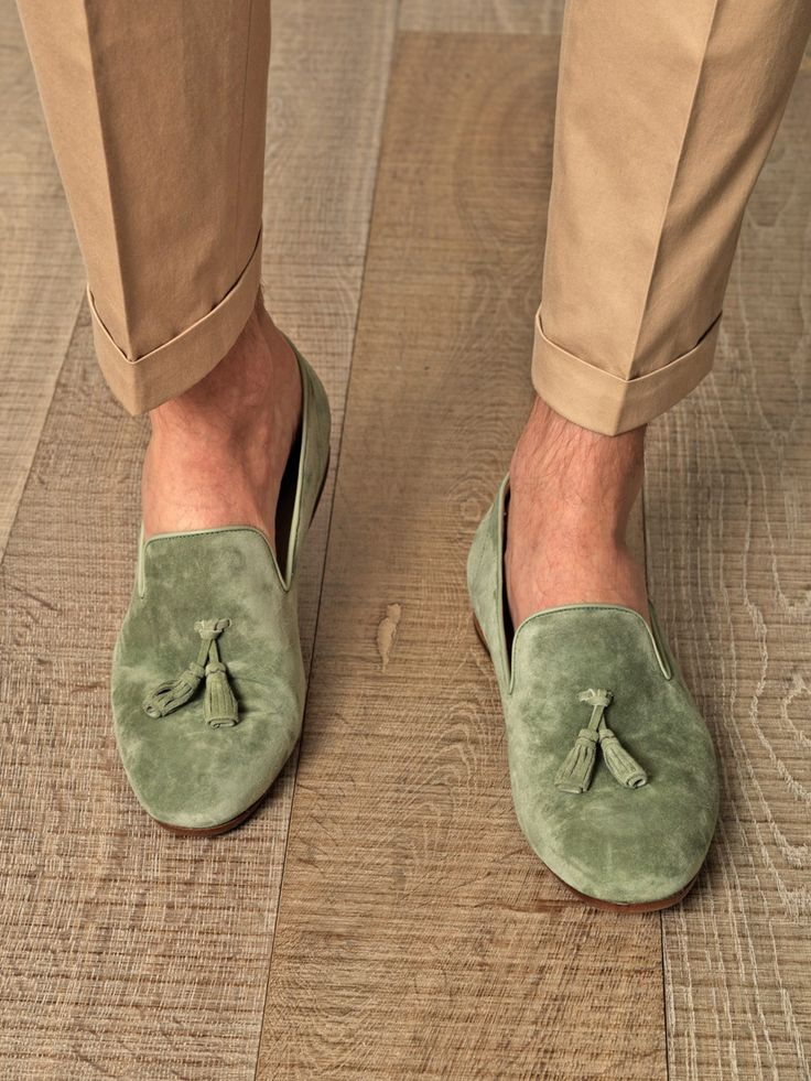 Sage-green suede loafers with a tassel detail, round-toe, leather-trimmed edges and a short stacked wooden heel. Sporting the colour of the season for menswear, these Alexander McQueen loafers are as classic as they are on-point for smart-casual perfection.