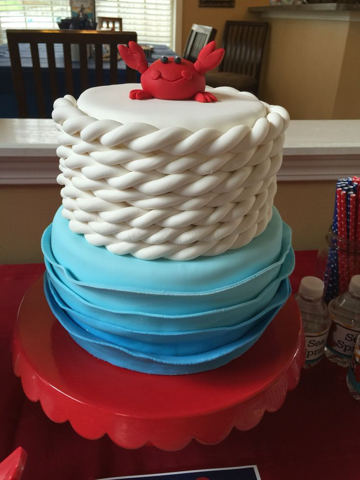Ridge's 1st birthday, nautical ahoy matey...fondant rope, fondant ombré waves, and fondant crab...over Swiss meringue buttercream.