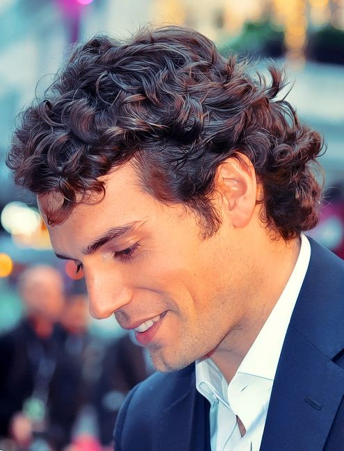 Henry Cavill love his curly hair... want to put my fingers through them!!