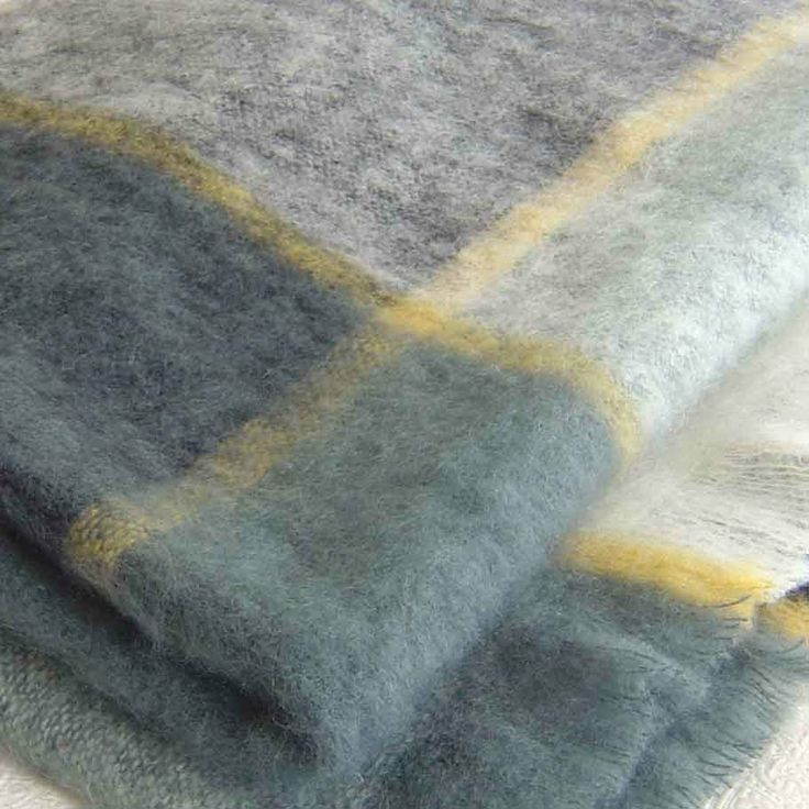 Gorgeous grey check throw blanket in Mohair, from Mohairs & More : http://mohairsandmore.com/designer-check-throws-in-mohair/