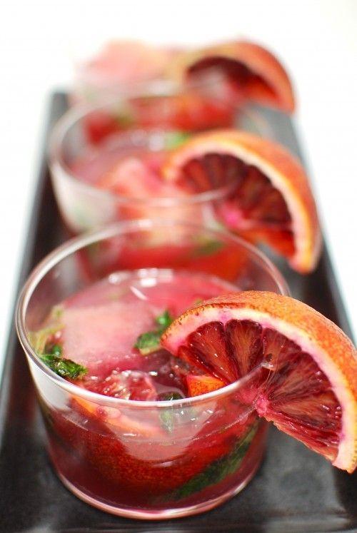 A yummy and particular San Pellegrino Blood Orange Mojitos made with rum and San Pellegrino Limonata