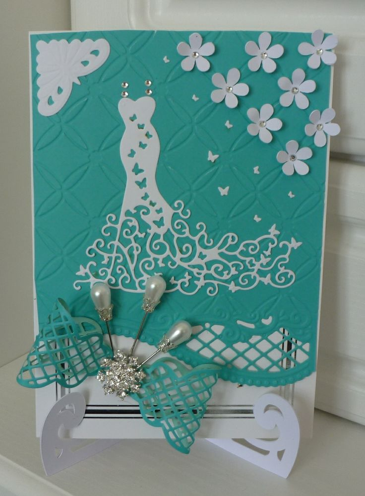 Tattered lace dress die. Inspiration for the bow from a tattered lace die of which I used a Marianne die,the card stand flowers were from a file I down loaded to cut on my silhouette