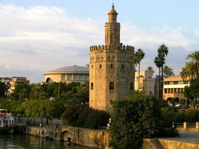 La Torre del Oro de Sevilla es una torre albarrana situada en el margen izquierdo del río Guadalquivir, en la ciudad de Sevilla, junto a la plaza de toros de la Maestranza. Fue declarada monumento histórico-artístico en 1931 y ha sido restaurada varias veces. Comenzó su construcción el 30 de marzo de 1220, siendo terminada el 24 de febrero de 1221.