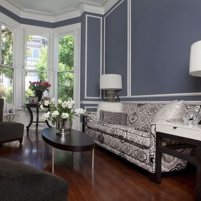 Blue Gray Walls Are Accentuated By White Wall Frame Molding In This Posh Living Room The Traditional And Crown Moldings Balanced Glass