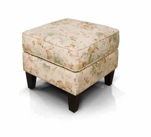 The Loren ottoman features a welted box cushion top with a smooth base. High tapered legs match the ones on the Glenna chair.
