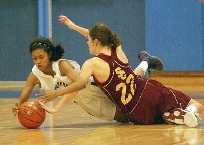 CCHS' Faith Welch and Colonie's Laura Kipper (22) battle for the ball on the floor during fourth quarter of high school girls sectional basketball action Friday, February 23, 2012 at Shaker High School. (J.S. Carras / The Record)