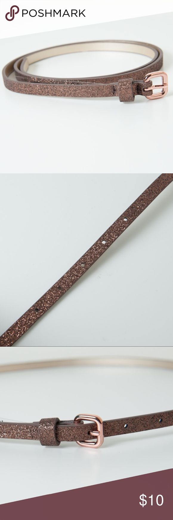 Joe Fresh Glitter Skinny Belt NWOT Bronze Gold Lg Bronze/Gold glitter belt from Joe Fresh. New without tags. Get your daily dose of glamour with a glittery belt. Faux leather with glitter, 100% polyurthane. Large Joe Fresh Accessories Belts