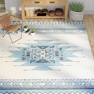 Give your foyer ensemble a splash of Southwestern-inspired style or complement a weathered wood hall tree in the entryway with this eye-catching rug, printed with a geometric motif in aqua.