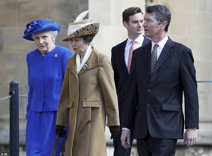 Princess Anne, centre, and her husband, Vice Admiral Sir Timothy Laurence, right, arrive for the church service