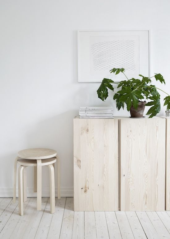 Rustic Scandinavian hallway featuring Alvar Aalto's design classic the Artek E60 Stool : https://www.utilitydesign.co.uk/artek-60-stool
