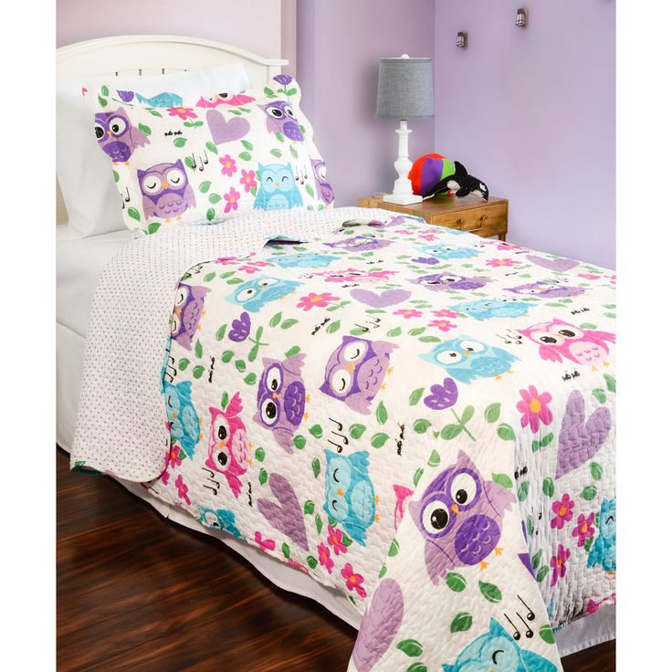 Add a flight of fancy to your child's room with this adorable quilt covered in owls, hearts, and tulips. Reversible to a complementing polka dot pattern, this quilt is finished with vermicelli embroidery and scalloped edges for added style and durabilty.