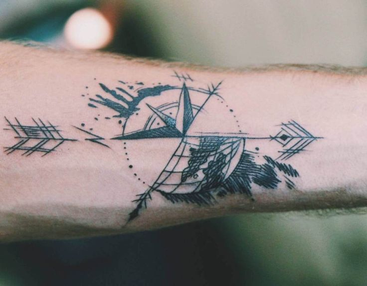 A photo of my new travel tattoo representing overcoming an intense incident  when Travel Makes You Want to Quit Traveling. This is a compass and globe with an hour glass in the center. Read the article here. | Lost Boy Memoirs