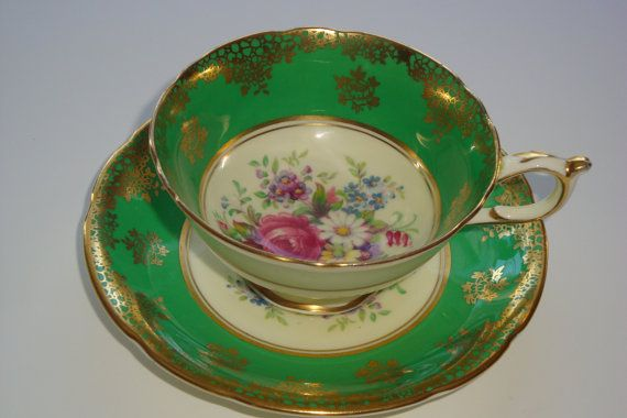 Absolutely amazing selection of DW Paragon tea cups and saucers. Price shown is for ONE SET ONLY. All sets are identical except for the background color. The floral centers are so lovely and there is gold gilding on the ground color as well as gold trim on the rims and handles. Footed cups stand 2 1/8 by almost 4 across and the saucers are 5 1/2 in diameter. EXCELLENT condition with NO chips, cracks, paint or trim loss and no signs of wear. What a wonderful addition to any collecti...