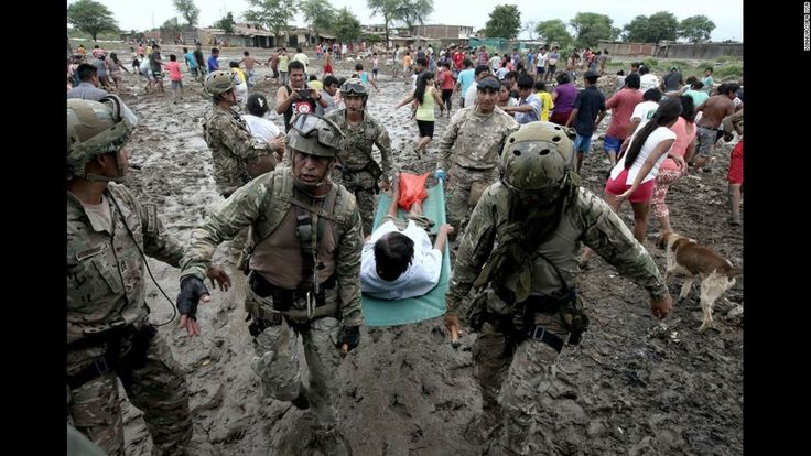 """Soldiers help with evacuations in Piura, Peru, on Wednesday, March 29. More than half a million people in and around the country's capital of Lima <a href=""""http://www.cnn.com/2017/03/20/americas/peru-floods-mudslide-toll/"""" target=""""_blank"""">have been affected by storms and flooding,</a> authorities said last week. Weeks of rain have caused rivers across the country to rise."""