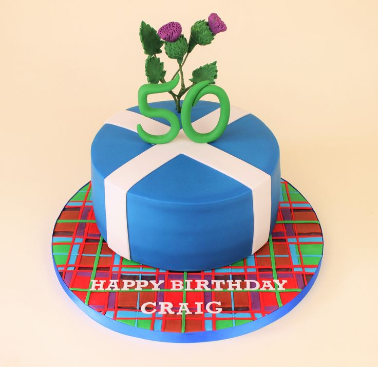 Scottish cake with thistles, tartan and the flag of Scotland