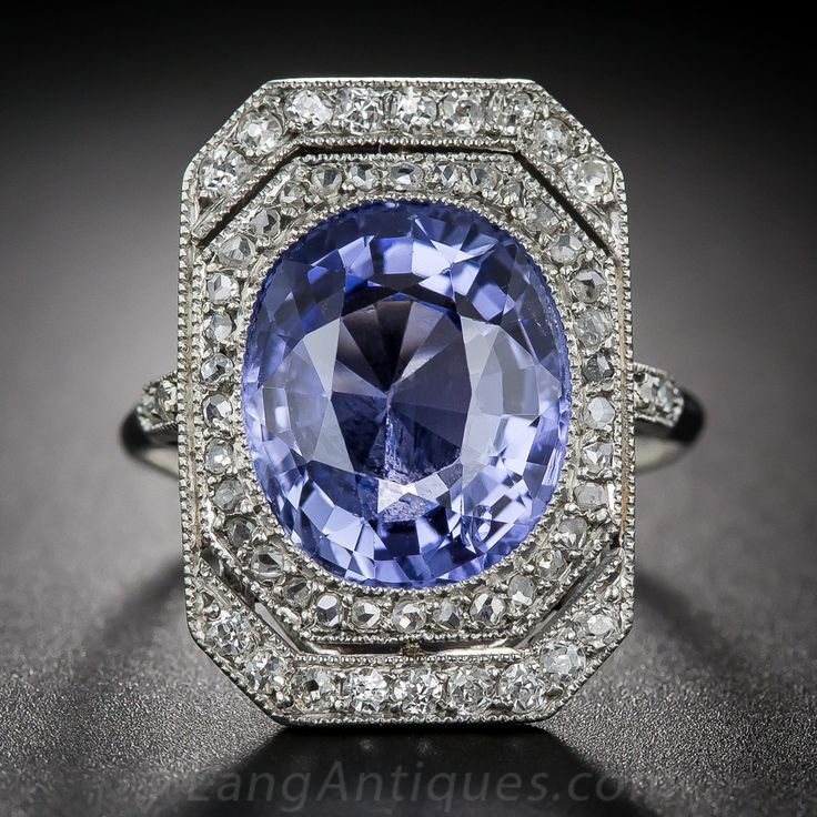 7.00 Carat Sapphire Diamond Edwardian  Ring. La Belle Epoch romance, radiance and refinement coalesce in this extraordinary French made adornment - circa 1900. A bright and beautiful lavender hued blue sapphire, weighing 7.00 carats, glistens day and night from within a delicate double-tiered platinum frame glittering with old mine single-cut and rose-cut diamonds.