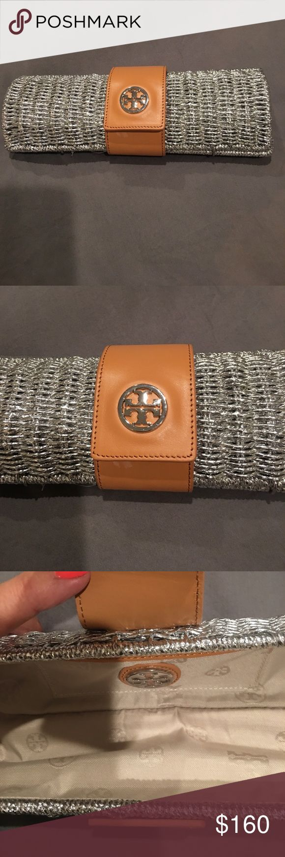 Tory Burch Silver Metallic Clutch Authentic Tory Burch silver metallic clutch with leather flap used once. Tory Burch Bags Clutches & Wristlets