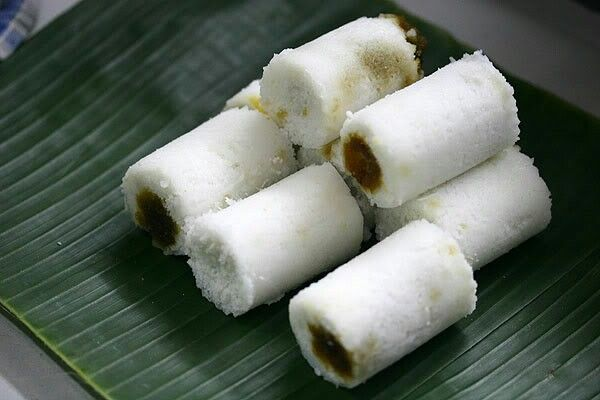 It's called Putu cake. Made from rice flour filled with brown sugar. Tasty and sweet