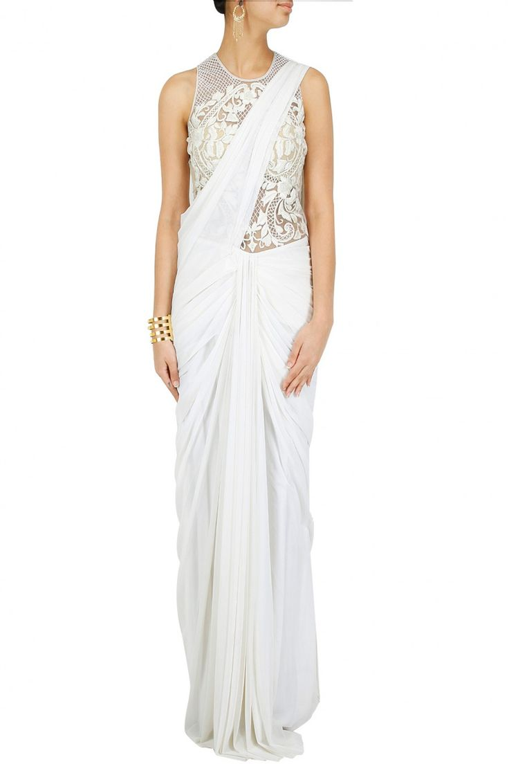 White embroidered fringe pallu pre stitched sari-gown BY SONAAKSHI RAAJ. Shop now at perniaspopupshop.com #perniaspopupshop #clothes #womensfashion #love #indiandesigner #sonaakshiraaj #happyshopping #sexy #chic #fabulous #PerniasPopUpShop #ethnic #fun