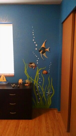 Just finished painting grasses and bubbles around plastic fish for the kids under the ocean bedroom.