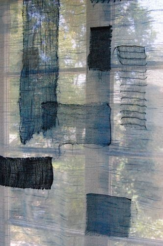 Boro-style curtain.  Indigo dyed fabric, made into patch curtains.