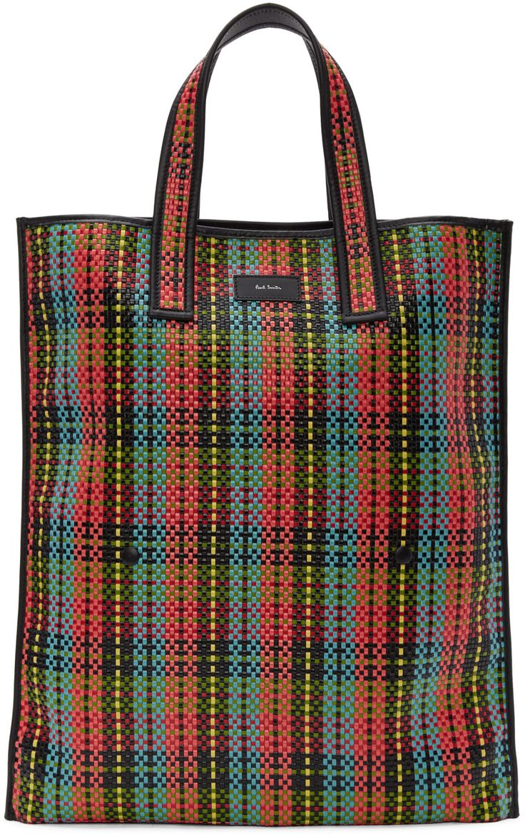 Faux-leather tote bag featuring multicolor check print woven throughout. Buffed leather trim in black throughout. Twin carry handles. Leather logo patch at face. Leather logo patch, zippered pocket, and patch pockets at interior. Textile lining in black. Tonal stitching. Approx. 17