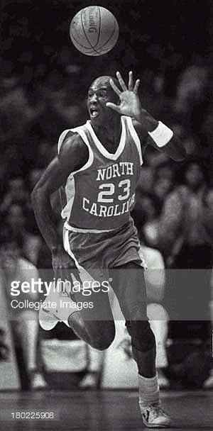 Michael Jordan, #23 guard of the University of North Carolina Tar Heels men's basketball team dribbles the ball upcourt during a game at Carmichael Arena in Chapel Hill, North Carolina.