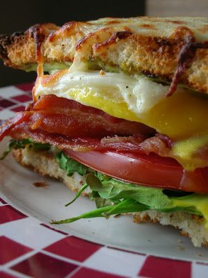 Bacon, Egg, Lettuce and Tomato Sandwich. Melted mozzarella on top of the warm, fried egg....  SO sumptuous!!