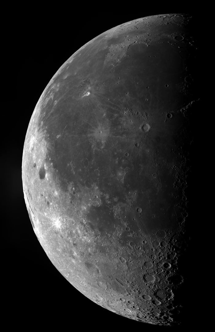 """A close-up view of our moon detailing the many craters on its surface. The mosaic of 16 frames captures the craters of Copernicus, Kepler, Aristarchus, and Grimaldi, which were created between 3.8 to 4.1 billion years ago from continuous impacts from high-speed asteroids, in a period that is known as the Late Heavy Bombardment. Also seen in the image is the gloomy Ocean of Storms, a huge lunar mare or sea, made up of solidified basalt from volcanic activity that took place after the Late…"