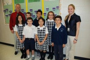 L to R: (back row) Lou Goldberg, principal of St. Matthew's Catholic School, who implemented The Leader in Me program when he came onboard l...
