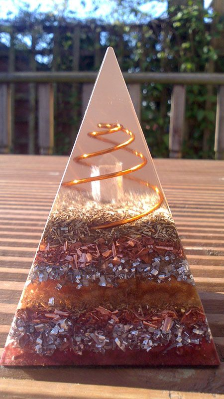 Stunning Hand Coiled Nubian Orgone Pyramid with clear quartz single point. Grounding colours make this a relaxing and soothing piece of orgonite. Crafted with love in Scotland