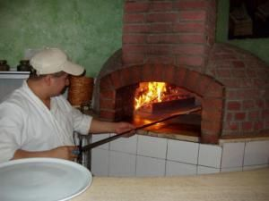 """Hmmm...interesting : The word """"pizza"""" is thought to have come from the Latin word pinsa, meaning flatbread. A legend suggests that Roman soldiers gained a taste for Jewish Matzah while  in Roman occupied Palestine and developed a similar food after returning home. By the Middle Ages these early pizzas started to take on a more modern look and taste..."""
