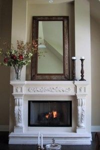 Give Your Fireplace A Makeover: Seville Legs with Parisian Shelf Stone Mantel Shown in Smooth White Stone Finish. http://www.mantelsdirect.com/mantel-blog/Cast-Stone-Mantels-Give-Your-Fireplace-a-Makeover