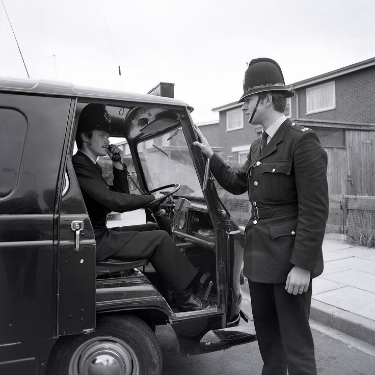 Two Greater Manchester Police officers at work in Hulme back in 1976. This image is from a series taken as part of a recruitment drive, they were to accompany a short film about the appeal of a career in policing. It may seem strange, especially in this age of very limited police recruitment, but getting people to join the service was difficult at this time. www.gmpmuseum.co.uk