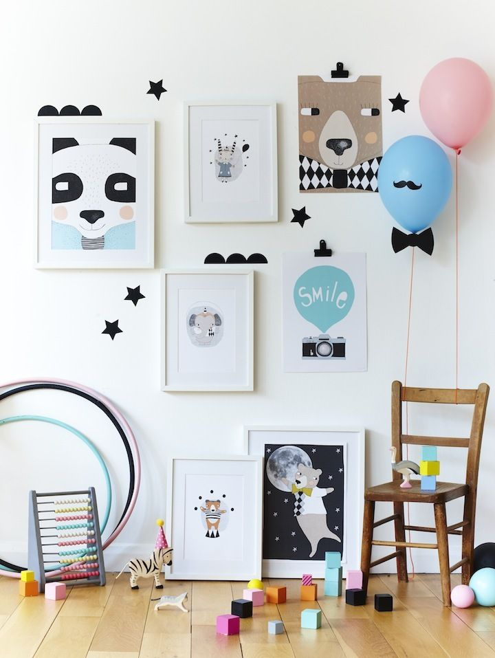 This adorable wall gallery is perfect for any child's room. An animal wall art gallery gives this room a little fun flair! Hula hoops & blocks ensure your kiddos will be busy.