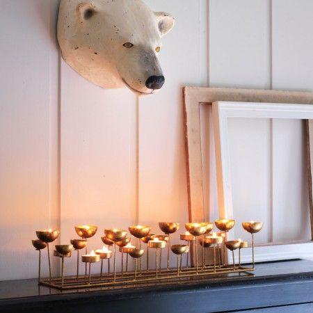 http://www.grahamandgreen.co.uk/gold-multi-tea-light-holder Gold Multi Tea Light Holder £45