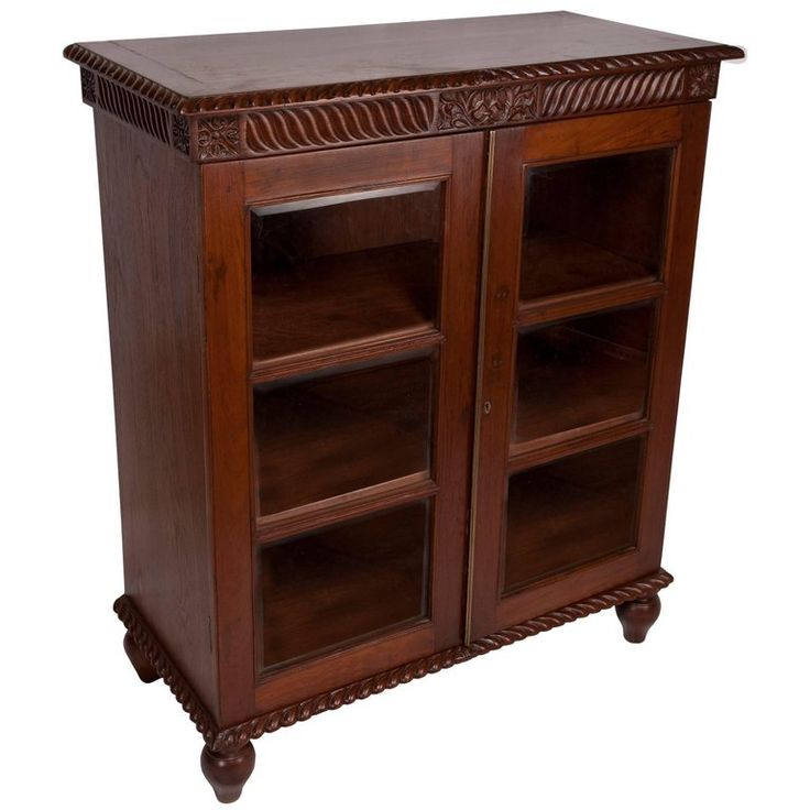 British Colonial Mahogany Petite Bookcase with Glass Door Panels, Early 1900s | From a unique collection of antique and modern bookcases at https://www.1stdibs.com/furniture/storage-case-pieces/bookcases/
