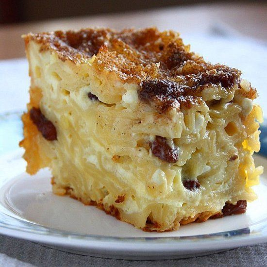 Noodle Kugel: A sweet noodle casserole made with cottage cheese, sour cream and raisins that has a custardy interior and a crunchy sugar topping.