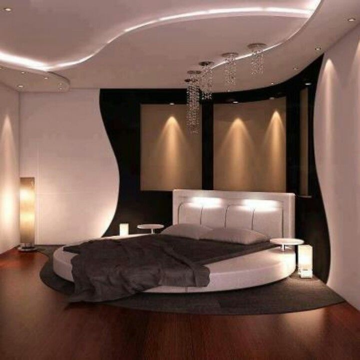 Super sexy bedroom complete with circular bed and satin for Nice bedrooms