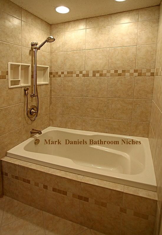 Recessed lighting minus soffett - LOVE  large tiles w/ mosaic stripe - LOVE  soaking tub - LOVE  Built-in shelves (but need more) - LOVE  Negative on the shower faucet, but hey...