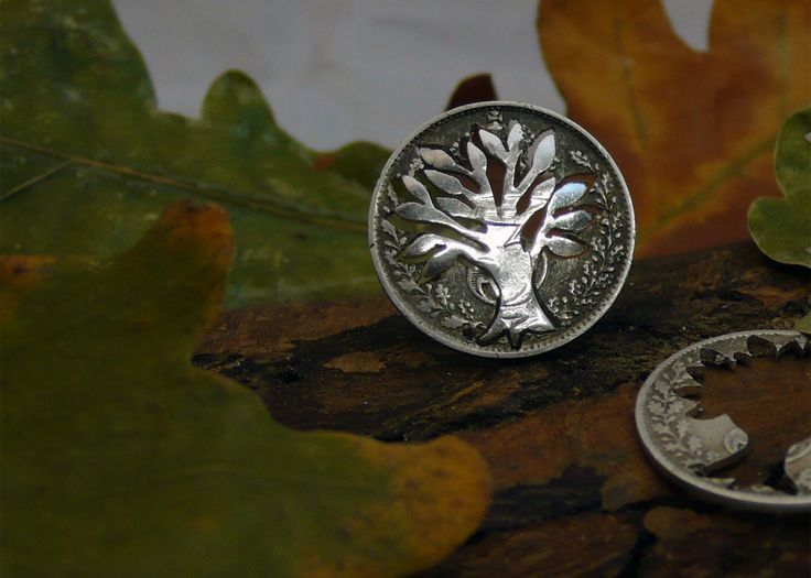sterling silver threepence coin being 'cut-out'