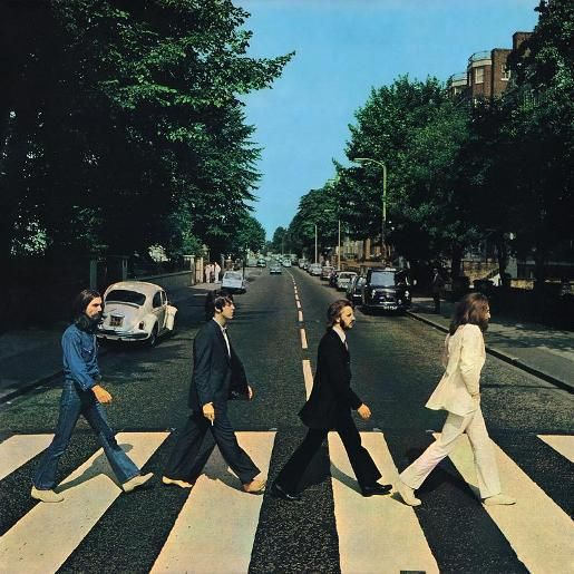 The Beatles Abbey Road album, released on 26 September 1969, became a pop culture icon through the album cover designed by Apple Records creative director John Kosh and photographed by British photographer Iain Macmillan.    The photograph for the back cover was taken on the corner of Abbey Road and Alexandra Road and includes a girl in a blue dress who inadvertently walked in front of the camera during the shoot.