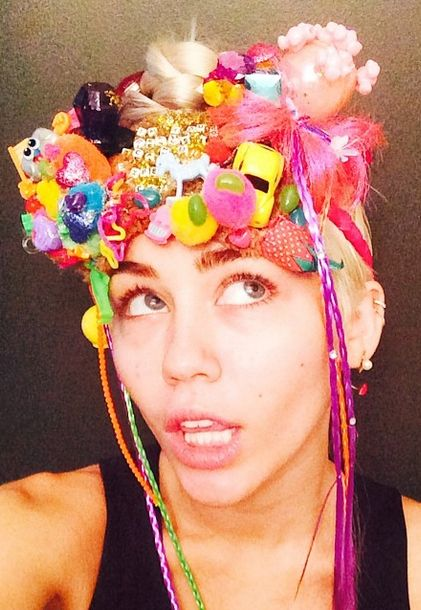 """Miley Cyrus on her """"Dirty Hippie"""" art collection: """"Money can buy you a bunch of sh*t to glue to a bunch of other sh*t that will make you happy."""""""