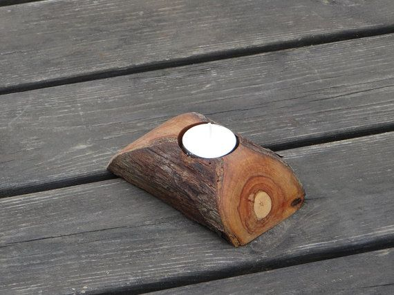 Wooden candle holder. Handmade from apple wood. Finished with linseed oil. Candle included.  Size length 13 cm ( 5,1 in. )   hight 5 cm ( 2 in. )